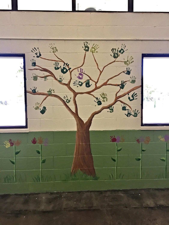 """Handprint """"leaves"""" on tree"""