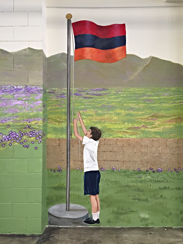 """Student"" hanging the Armenian flag"
