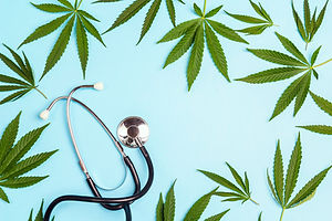 Medical cannabis and stethoscope on a bl