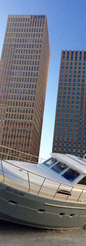 stranded yacht in square amsterdam zuidas gustav mahlerplein metaphor financial crisis iphoneonly symphony buildings