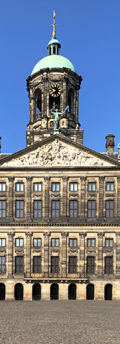 frontal picture of royal palace on the dam amsterdam with no people in square during lockdown corona