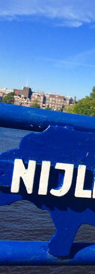 nijlpaardenbrug entrepotdok artis blauw met wit lang naambord