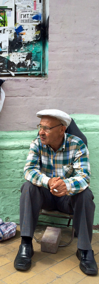 kiev ukraine retired man in the street classy green and lila hat picture perfect