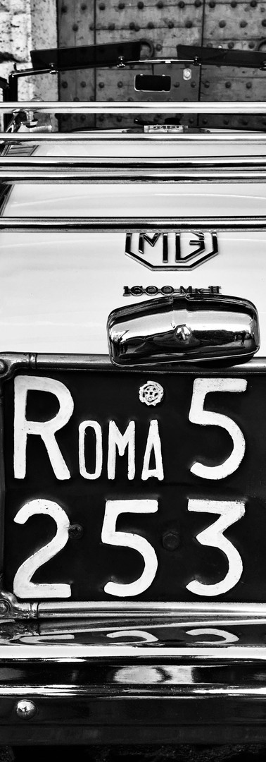 rome italy roma numberplate on mg cabriolet black and white