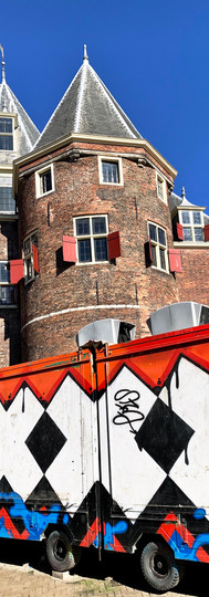 de waag with XXX in front against blue sky ionamsterdam nieuwmarkt