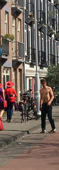 women in red and purple men nude chest black trousers in the street westerpark amsterdam iphoneonly