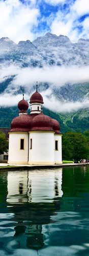 koenigssee germany st bartholomae green water watzmann white church with red domes clouds on the mountains awe-inspiring