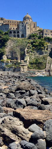 castello aragonese ischia grey basalt rocks blue water castle on rock capri in the distance italy sunshine