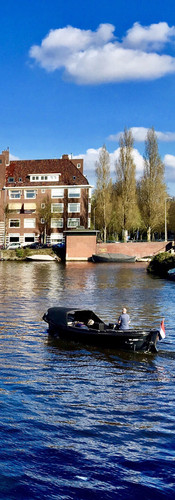 springtime amsterdam boat passing by harbour club apollolaan boerenwetering oud-zuid iphoneonly