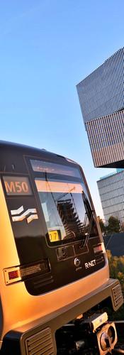 metro m50 at amsterdam rai station with nhow amsterdam rai hotel behind