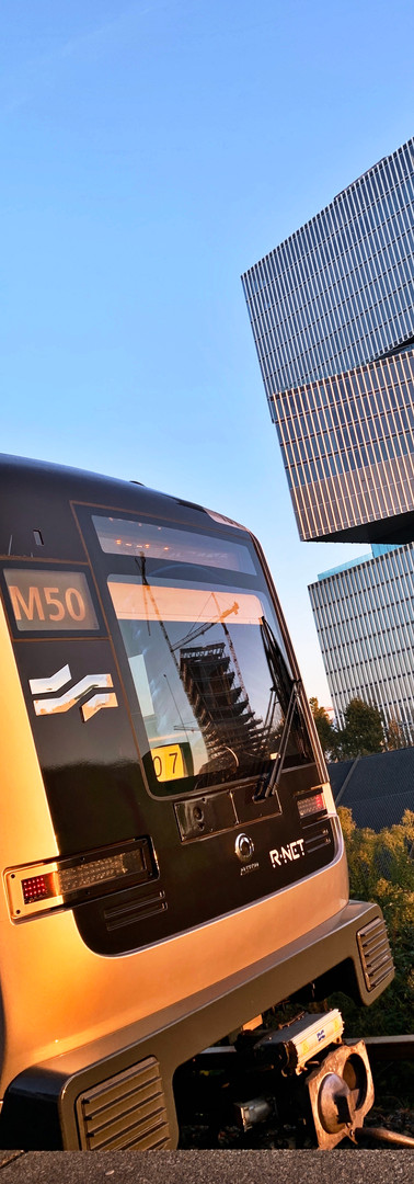metro m50 at amsterdam rai station with nhow amsterdam rai hotel behind
