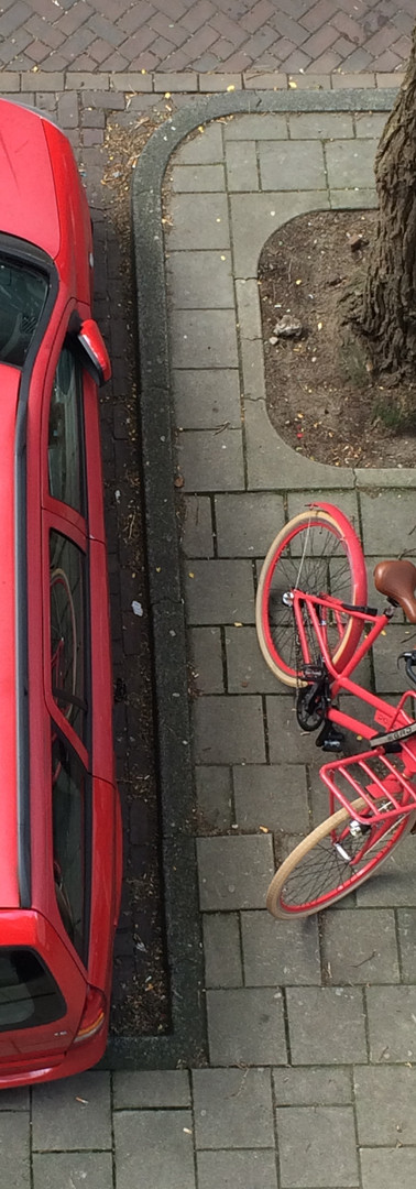 red car and red bicycle parked next to each other view from above jan luijkenstraat amsterdam centrum iphoneonly