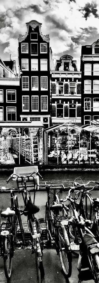 singel amsterdam flower market canal houses bicycles clouds black and white architecture ionamsterdam
