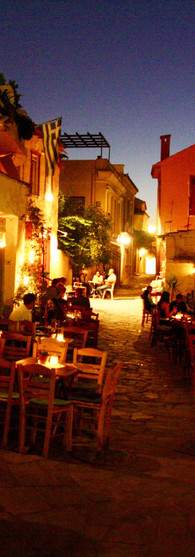 athens evening dinner time outside atmosphere yellow orange and blue light