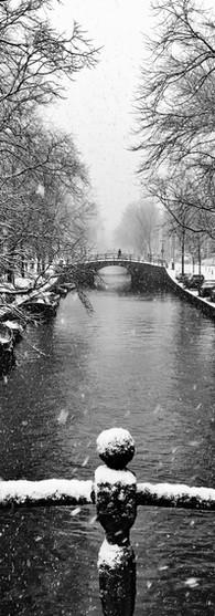 snow in amsterdam canals reguliersgracht bridges wintertime iphoneonly