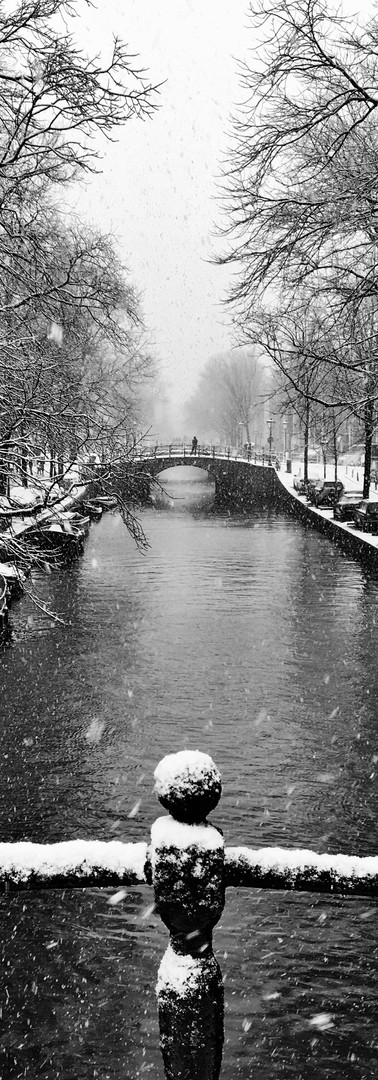 snow in amsterdam canals reguliersgracht bridges wintertime iphoneonly