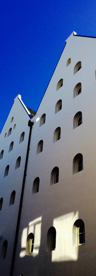 almost surreal white facades of prinseneiland amsterdam against blue sky
