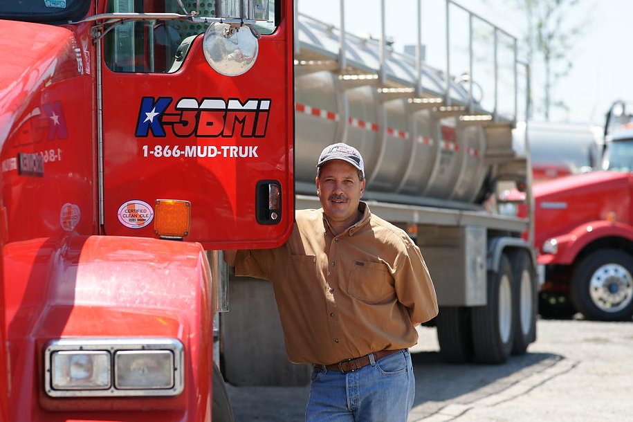 Karlis Ercums, CEO, poses with a red truck