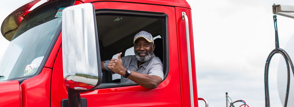 K-3BMI driver gives a thumbs up from the cab of a truck