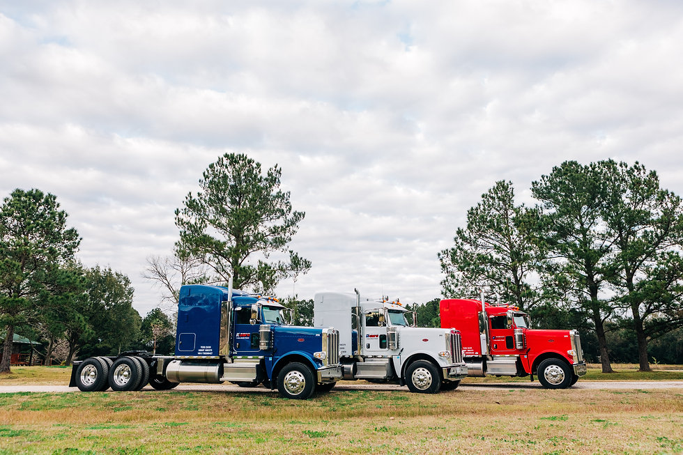blue, white, and red tractor trailer units