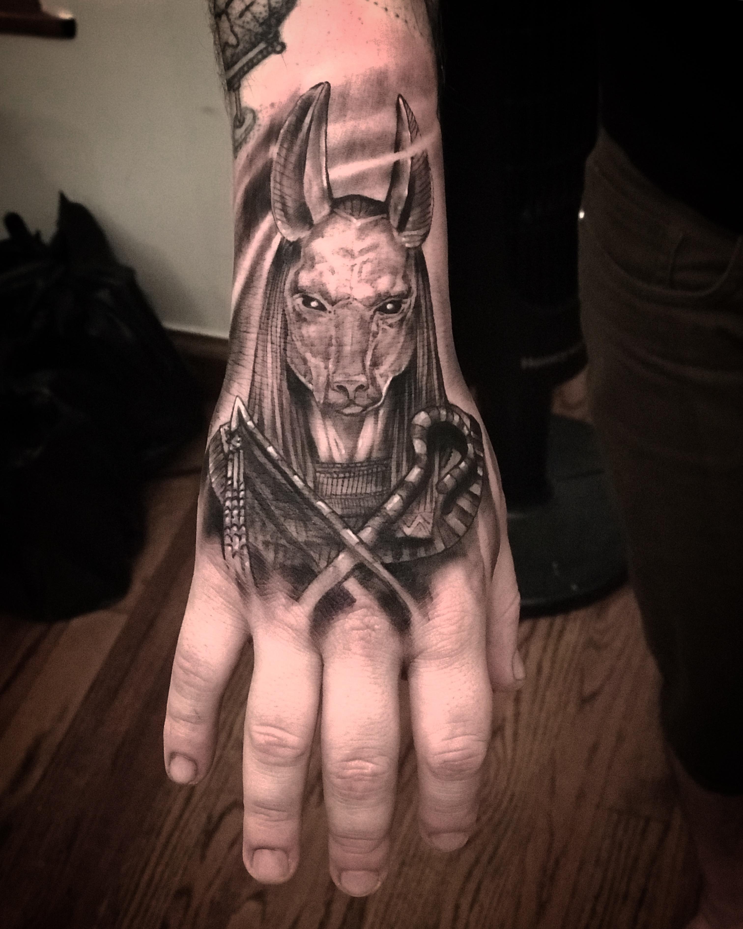 Anubis hand tattoo