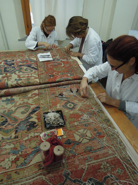 ricostruzione intreccio di fondo di un tappeto a nodi