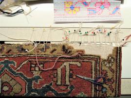 annodatura su tappeto secondo lo schema dei motivi decorativi