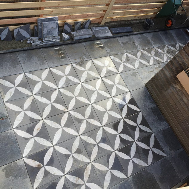 Large garden re-design and stone patio installation in Middelburg, Netherlands.