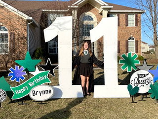11 with green, black, and silver hologram accents with specialty cheer accents