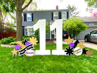 11 with gold, purple, black accents and