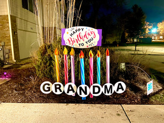 7 candles with Pink and Purple Happy Birthday topper
