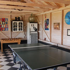 Detached games room with table tennis, football table, darts