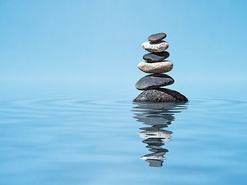 Rocks stacked, in a pool of water