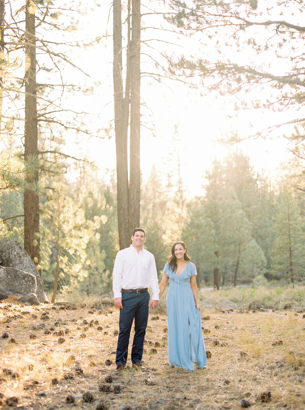 engaged couple in woods of Lake Tahoe