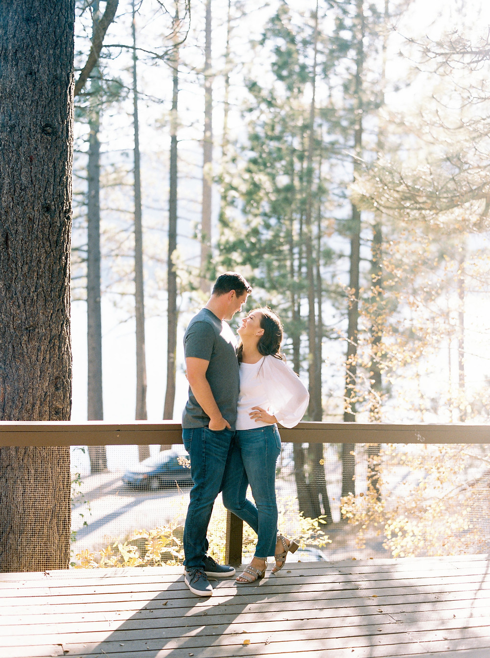 engaged couple on back porch of family cabin in Lake tahoe
