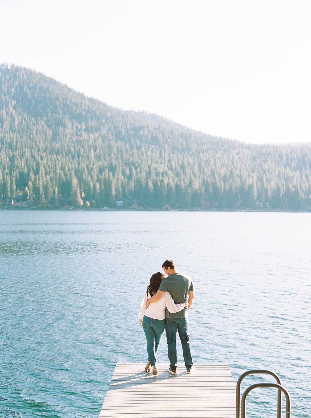 Engaged couple on pier at Lake Tahoe