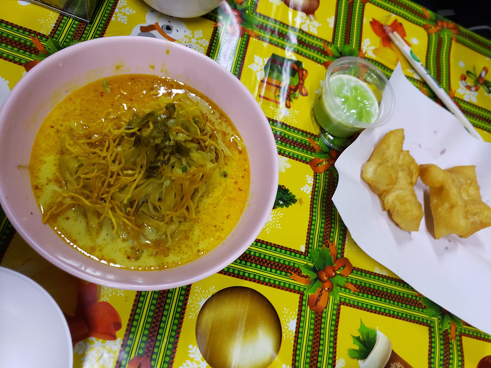 Kao Soi, a famous Chiang Mai Dish, at the street food market in Chiang Mai, Thailand