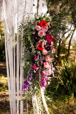 floral wedding arch with macrame