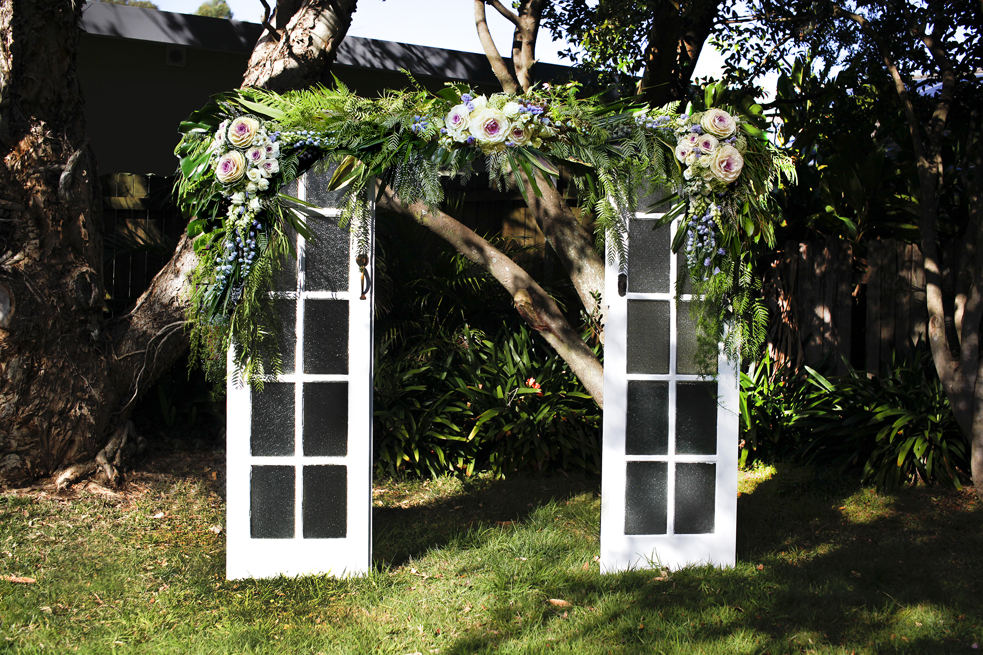 refurbished white door wedding arch