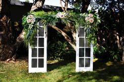 refurbished white door wedding arch