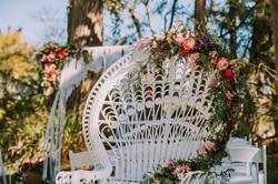 floral arrangement on peacock chair