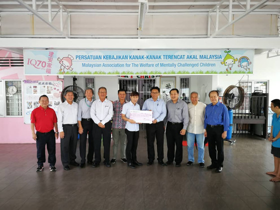Presentation of aid of RM15,300.00 by Edward Holiday Lodge No. 7997 and District Grand Lodge to the