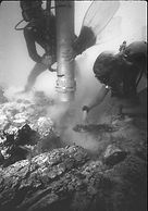 Divers uncover a chest of silver coins at the wreck of the Atocha, 1985.