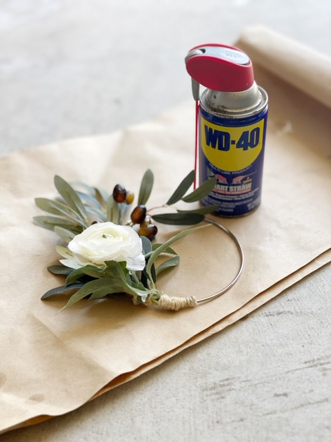 Learn how to weather proof your wreath with WD-40. #wreathtips
