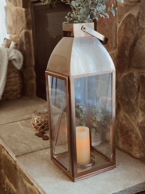 Fireplace hearth lantern with candle.