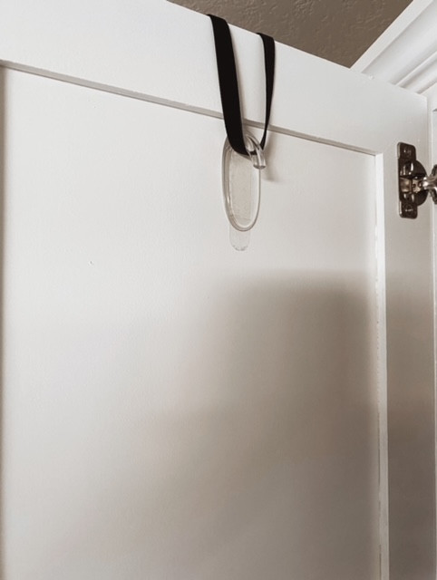 place a command hook upside down on a kitchen cabinet door