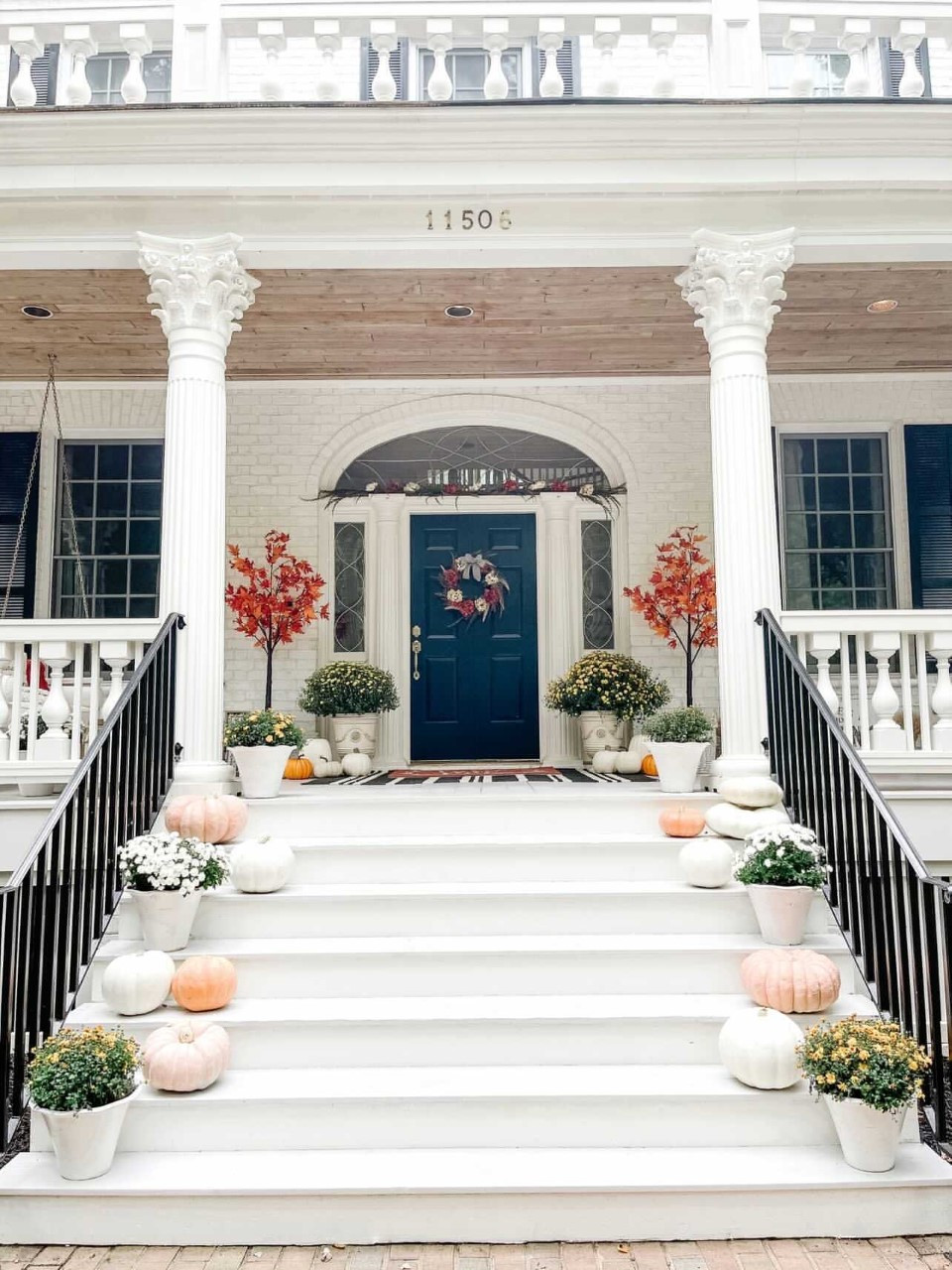 Front porch decorated for Fall featuring a DIY Fall garland and wreath