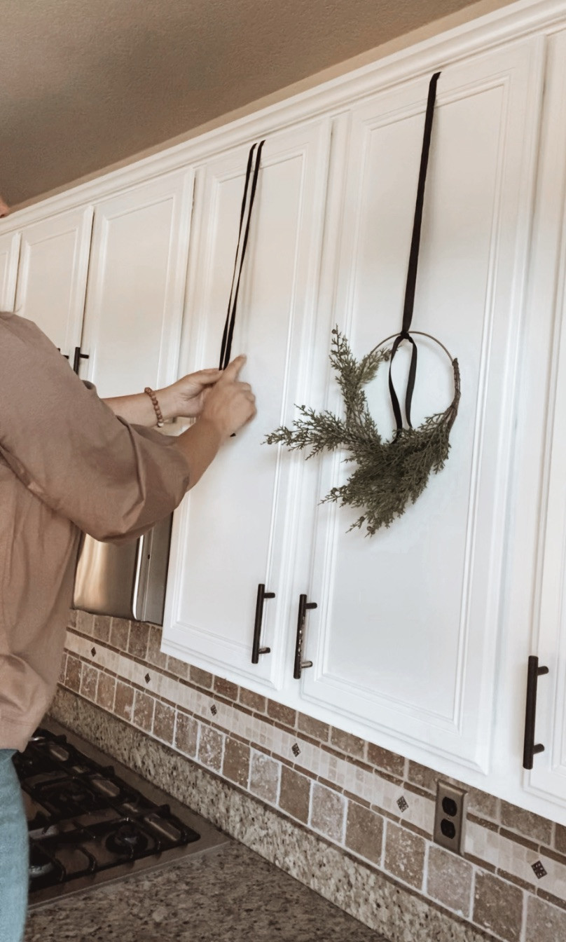 Use painters tape or masking tape to mark the height of your kitchen wreath