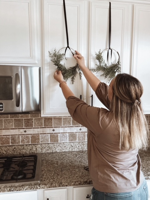 Learn how to hang mini wreaths on kitchen cabinet doors.