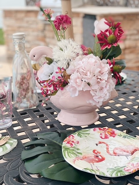 Flamingo themed brunch with flamingo plates and drinkware for the patio